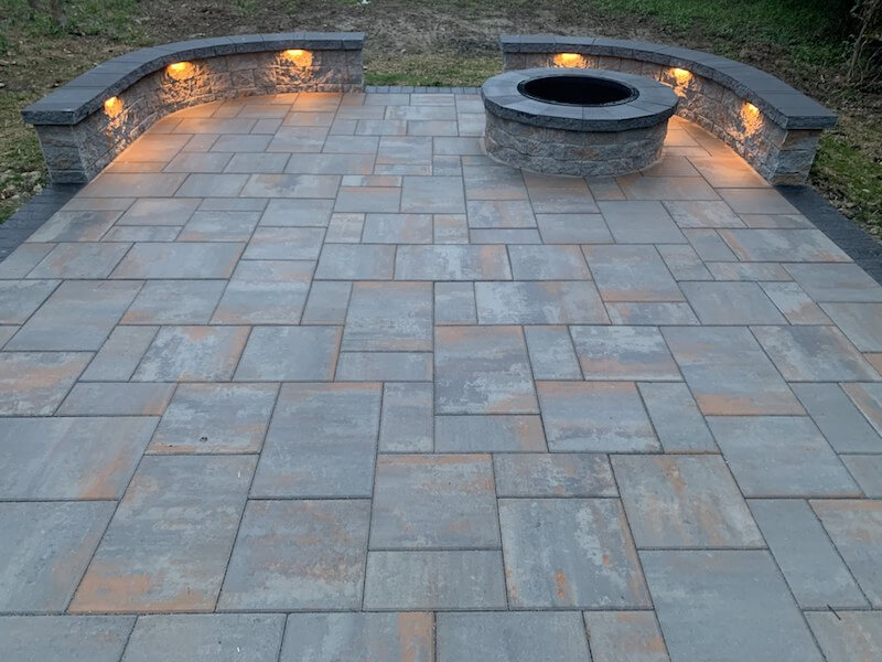 Paver Patio with a Fire Pit at Night